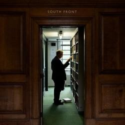 Reader browsing the shelves at the University Library