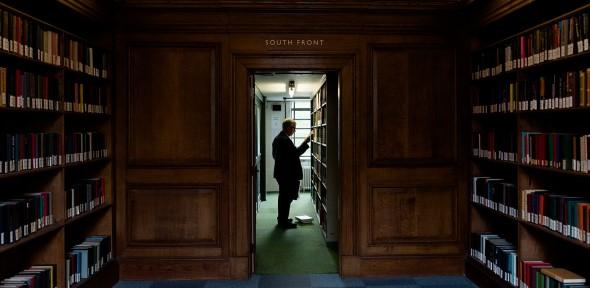 Library user browsing shelves on South Front